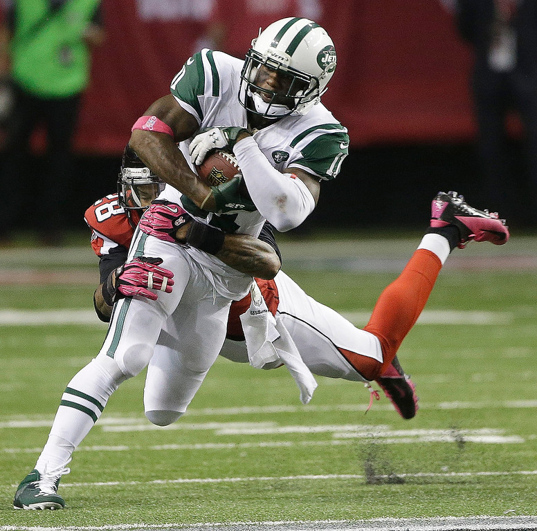 . Atlanta Falcons free safety Thomas DeCoud (28) tackles New York Jets wide receiver Jeremy Kerley (11) during the second half of an NFL football game, Monday, Oct. 7, 2013, in Atlanta. The Jets won 30-28. (AP Photo/John Bazemore)