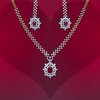 Beautiful Ruby and Diamond Jewelry Set Against a Red Background