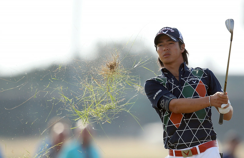 . Japan\'s Ryo Ishikawa plays from the rough on the16th hole during his first round 74, on the opening day of the 2014 British Open Golf Championship at Royal Liverpool Golf Course in Hoylake, north west England on July 17, 2014. (PETER MUHLY/AFP/Getty Images)
