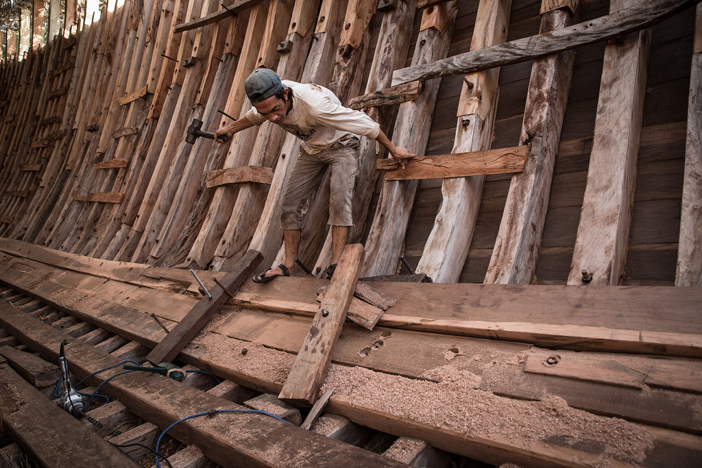 . A Buginese man works as he install a wooden block at Tanjung Bira Beach on May 2, 2014 in Bulukumba, South Sulawesi, Indonesia.  (Photo by Agung Parameswara/Getty Images)