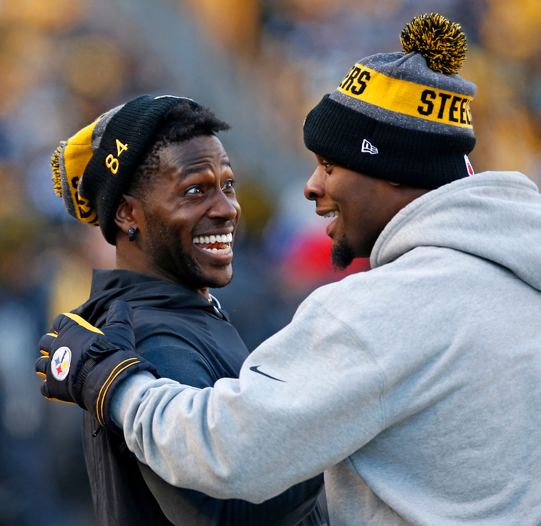 . Pittsburgh Steelers wide receiver Antonio Brown, left, and running back Le\'Veon Bell celebrate on the sideline after a Steelers touchdown during the second half of an NFL football game against the Cleveland Browns in Pittsburgh, Sunday, Jan. 1, 2017. (AP Photo/Jared Wickerham)