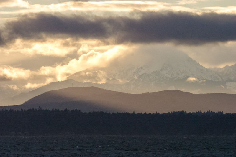 The Olympic Mountains are seen at sunset across Puget Sound from Seattle - Puget Sound, Seattle, Washington, United States (US)