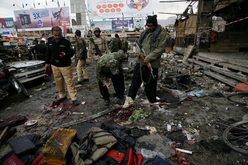 . Police officials search for evidences at the scene of a bomb explosion in Quetta January 10, 2013. A bomb blast in a crowded marketplace killed 11 people and injured more than 40 in Pakistan\'s eastern provincial capital of Quetta on Thursday and a local militant group claimed responsibility, police said. REUTERS/Naseer Ahmed