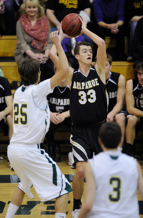 . Arapahoe guard Evan Walsh (33) looked to make an inbound pass in the second half. The Mountain Vista High School boy\'s basketball team defeated Arapahoe 69-54 Friday night January 4, 2013.  Karl Gehring/The Denver Post