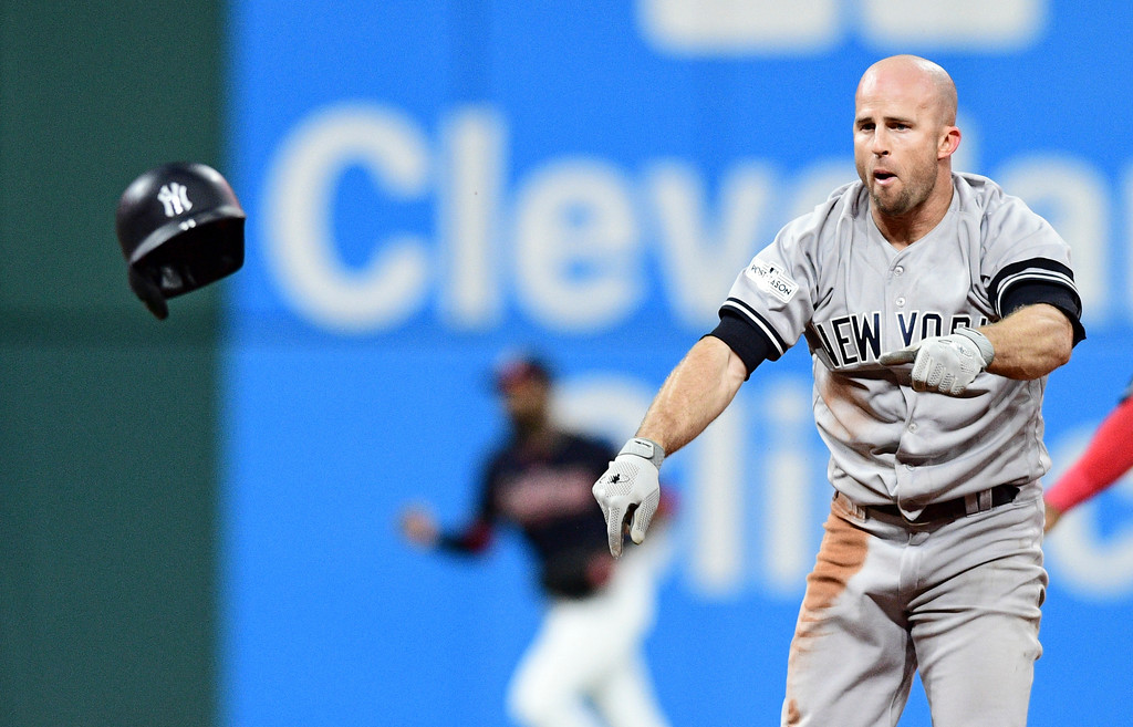 . New York Yankees\' Brett Gardner throws his helmet after getting tagged out trying to steal second base in the seventh inning of Game 5 of baseball\'s American League Division Series against the Cleveland Indians, Wednesday, Oct. 11, 2017, in Cleveland. (AP Photo/David Dermer)