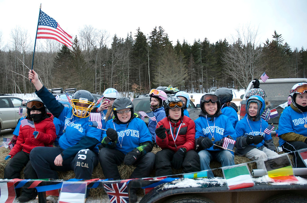 """. Kayla Rice/Reformer                                 Children from Dover ride in the parade for \""""Devin Day\"""" in Dover on Saturday."""