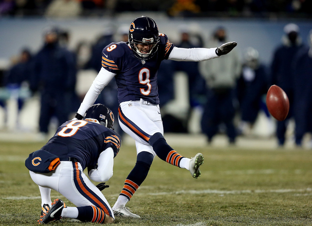 . Kicker Robbie Gould #9 of the Chicago Bears kicks against the Dallas Cowboys during a game at Soldier Field on December 9, 2013 in Chicago, Illinois.  (Photo by Jonathan Daniel/Getty Images)