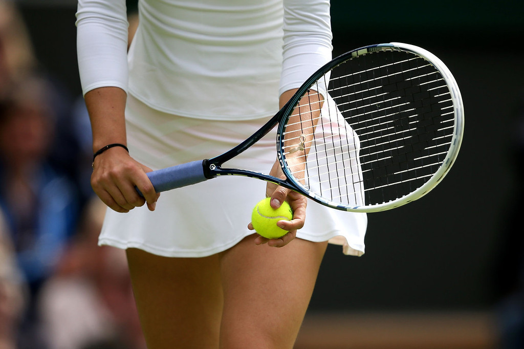 . Maria Sharapova of Russia serves during her Ladies\' Singles first round match against Kristina Mladenovic of France on day one of the Wimbledon Lawn Tennis Championships at the All England Lawn Tennis and Croquet Club on June 24, 2013 in London, England.  (Photo by Clive Brunskill/Getty Images)