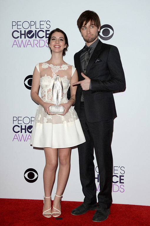 . LOS ANGELES, CA - JANUARY 08:  Actors Adelaide Kane (L) and Torrance Coombs, winners of the Favorite New TV Drama award for \'Reign,\' pose in the press room at The 40th Annual People\'s Choice Awards at Nokia Theatre L.A. Live on January 8, 2014 in Los Angeles, California.  (Photo by Jason Merritt/Getty Images)