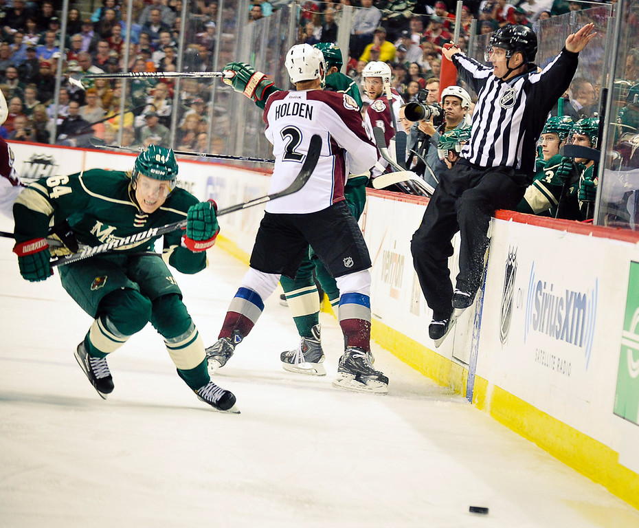 . The ref signals all is well as Minnesota\'s Mikael Granlund pursues a pass into the Colorado zone in the second period.  (Pioneer Press: Ben Garvin)