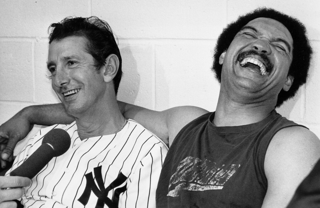 . New York Yankees manager Billy Martin, left, and his premier slugger Reggie Jackson laugh during a post-victory news conference at New York\'s Yankee Stadium, Tuesday night, Oct. 18, 1977.  Jackson clinched the World Series championship for the Yankees in game six against the Los Angeles Dodgers with an unprecented three consecutive homers in a series game.  The score was 8-4.  (AP Photo)