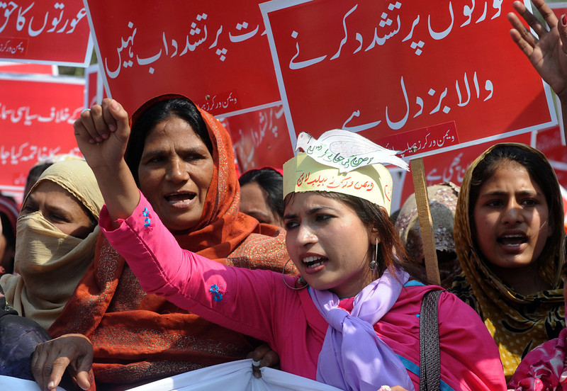 . Pakistani working women carry placards as they shout slogans during a rally on International World Women\'s day in Lahore on March 8, 2013. International Women\'s Day, observed on March 8 every year, highlights the economic, political and social achievements of women. Arif Ali/AFP/Getty Images