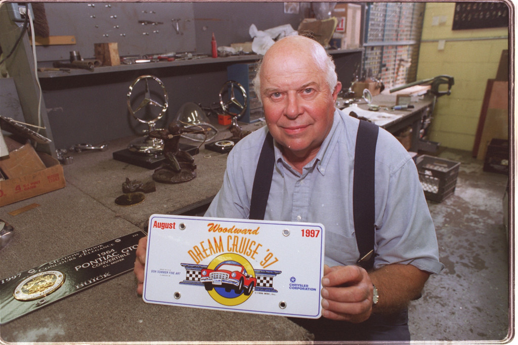 . don sommer created this commemorative license plate for the woodward dream cruise coming up on aug. 16th, seen here in his auto part reseration shop in clawson