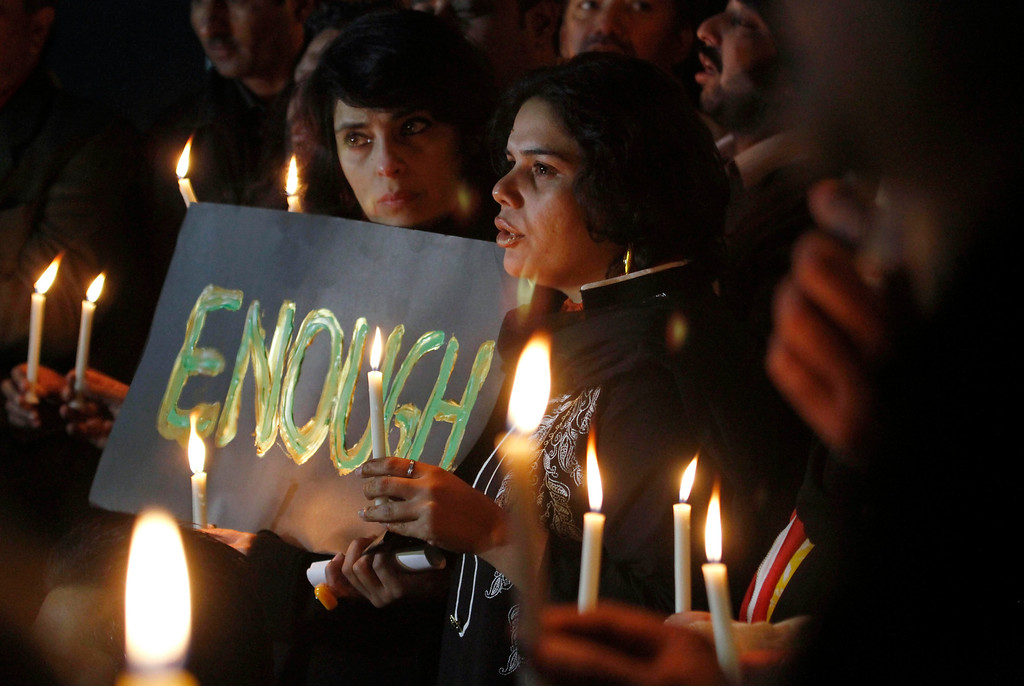 . Pakistani civil society members take part in a candle light vigil for the victims of a school attacked by the Taliban in Peshawar, Tuesday, Dec. 16, 2014 in Islamabad, Pakistan. Taliban gunmen stormed a military-run school in the northwestern Pakistani city, killing more than 100 people, officials said, in the worst attack to hit the country in years.(AP Photo/Anjum Naveed)