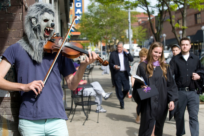 Zachary Storey, known as the Violin Monster, plays for pedestrians on Liberty Street in downtown Ann Arbor, MI on April 29, 2012.  He recently returned from a tour where he played the streets of major cities across America.
