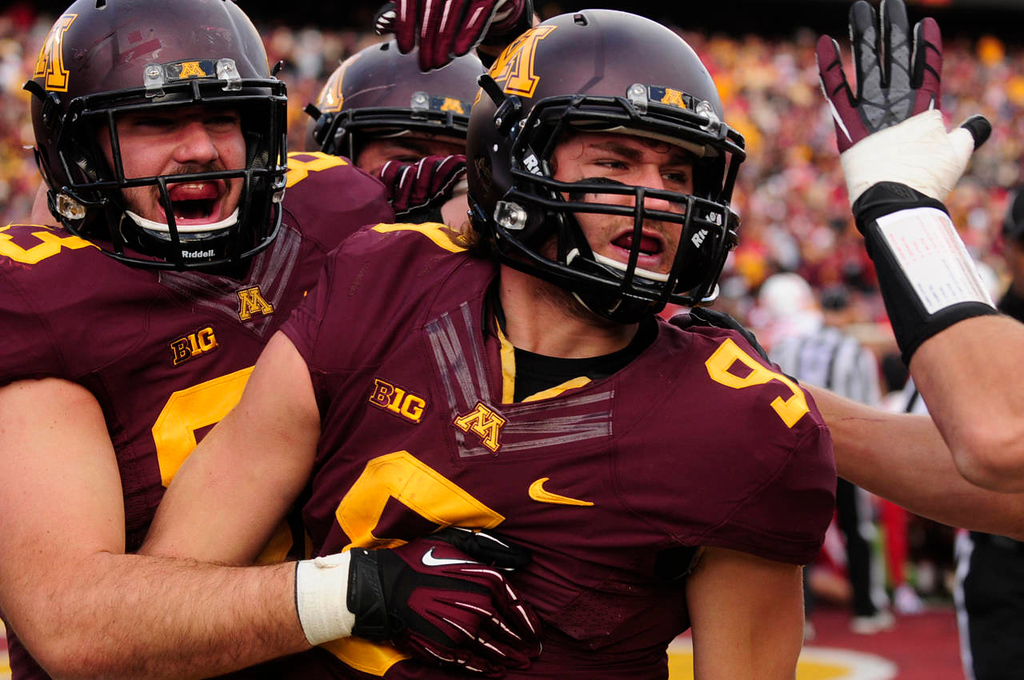 . Minnesota quarterback Philip Nelson, right, is congratulated by tight end Drew Goodger after Nelson scored a touchdown in the fourth quarter.  (Pioneer Press: Scott Takushi)