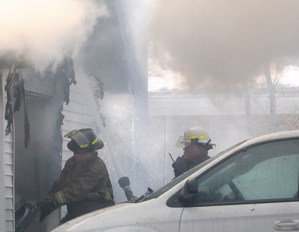 . Firefighters battle a blaze in a garage on University in downtown Mount Pleasant.(Sun photo by LISA YANICK-JONAITIS)