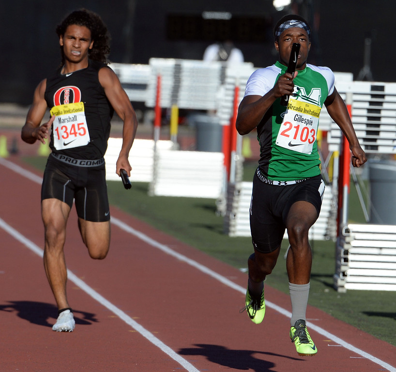 . Monrovia\'s Cravon Gillespie, right, ahead of Great Oak\'s Damion Marshall competes in the 4x200 Invitational during the Arcadia Invitational track and field meet at Arcadia High School in Arcadia, Calif., on Friday, April 11, 2014. Rocky Mountain won the race as Redondo Union finished second. (Keith Birmingham Pasadena Star-News)