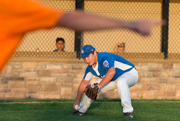 08/26/19 Wesley Bunnell | Staff The McCabe-Waters Astros defeated the Forrestville Dodgers 3-0 at Breen Field on Monday night in the city series to force a winner takes all on Wednesday. Nick Zygiel (10) fields a bunt and throws to first.