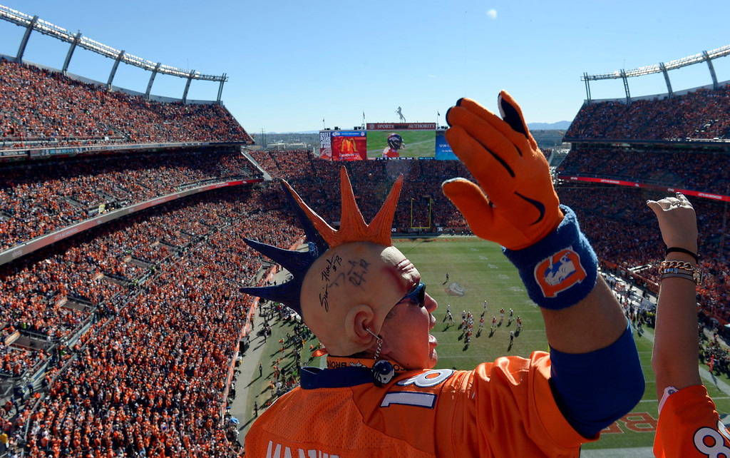 . Rubin Martinez cheers on the Broncos during the first half.  The Denver Broncos vs. The New England Patriots in an AFC Championship game  at Sports Authority Field at Mile High in Denver on January 19, 2014. (Photo by Craig Walker/The Denver Post)