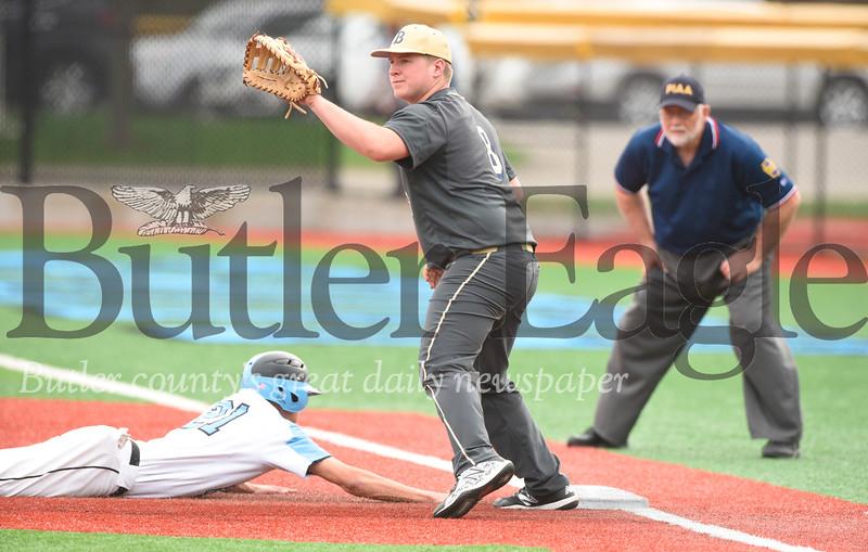 Butler first baseman J.R. Herold (8) attempts to catch Seneca Valley's Austin Shirley off base.