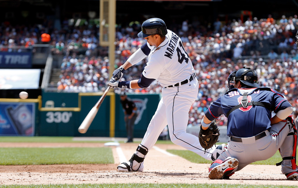 . Detroit Tigers designated hitter Victor Martinez hits a one-run double against the Minnesota Twins in the first inning of a baseball game in Detroit, Sunday, June 15, 2014. (AP Photo/Paul Sancya)