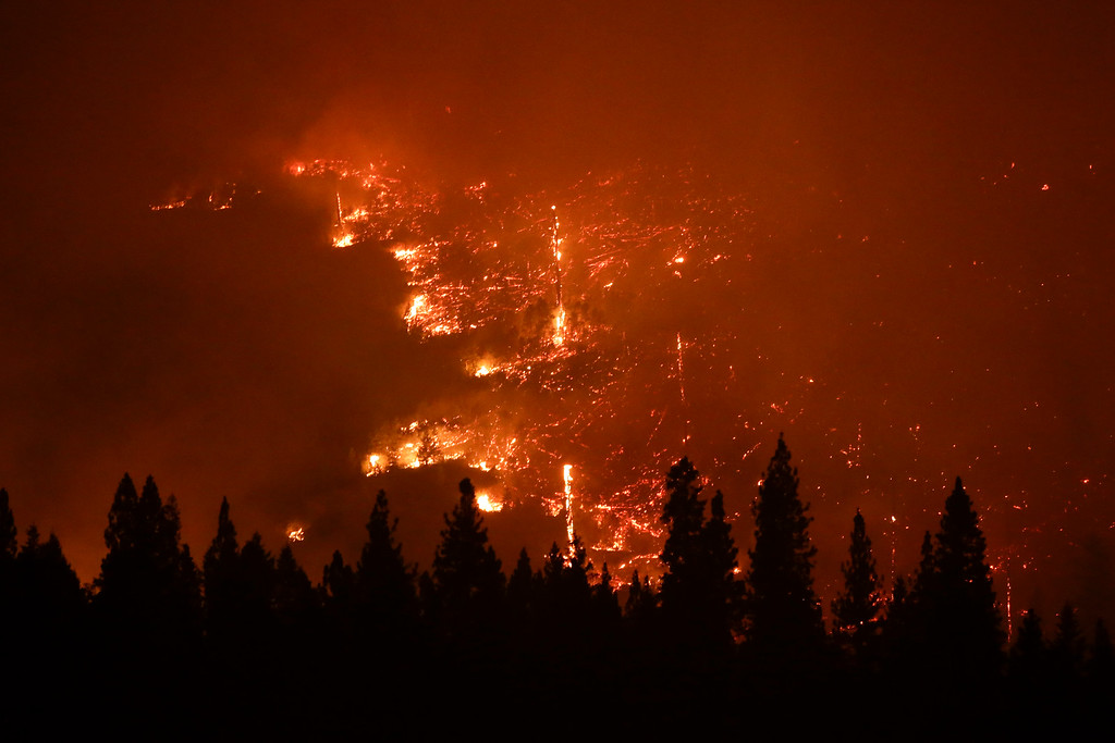 . A forest smolders as the Rim Fire continues to burn near Yosemite National Park, Calif., on Saturday, Aug. 24, 2013.  (AP Photo/Jae C. Hong)