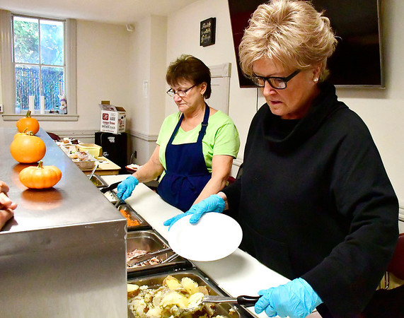 10/17/2018 Mike Orazzi | Staff Salvation Army volunteers Barb Fabrizio and Pat Brady while serving lunch at the Judd Street location in Bristol Wednesday.