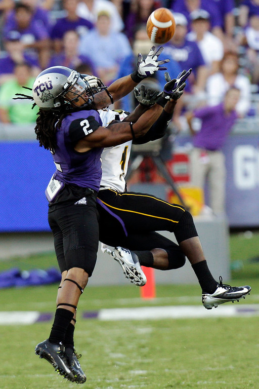 . In this Sept. 8, 2012, file photo, TCU cornerback Jason Verrett (2) breaks up a pass intended for Grambling State wide receiver Anthony McGhee (1) during the first half of an NCAA college football game in Fort Worth, Texas. Verrett was selected in the first round, 25th overall, by the San Diego Chargers in the NFL draft on Thursday, May 8, 2014. (AP Photo/LM Otero, File)