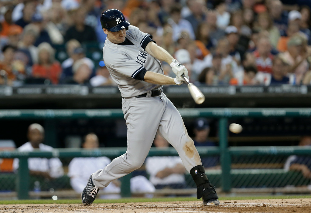 . New York Yankees\' Chase Headley singles against the Detroit Tigers in the third inning of a baseball game in Detroit, Wednesday, Aug. 27, 2014. (AP Photo/Paul Sancya)