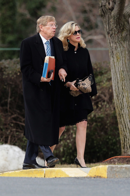 . Former United States Solicitor General Ted Olson (L) and his wife Lady Booth arrive for the funeral for U.S. Supreme Court Associate Justice Antonin Scalia at the the Basilica of the National Shrine of the Immaculate Conception February 20, 2016 in Washington, DC. Scalia, who died February 13 while on a hunting trip in Texas, laid in repose in the Great Hall of the Supreme Court on Friday and his funeral service will be at the basillica today.  (Photo by Chip Somodevilla/Getty Images)