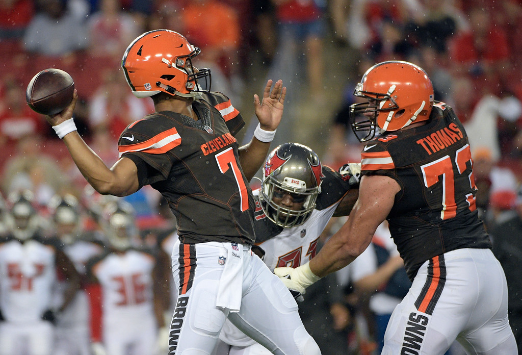 . Cleveland Browns quarterback DeShone Kizer (7) throws a pass as tackle Joe Thomas (73) blocks Tampa Bay Buccaneers defensive end Robert Ayers (91) during the first quarter of an NFL preseason football game Saturday, Aug. 26, 2017, in Tampa, Fla. (AP Photo/Phelan Ebenhack)