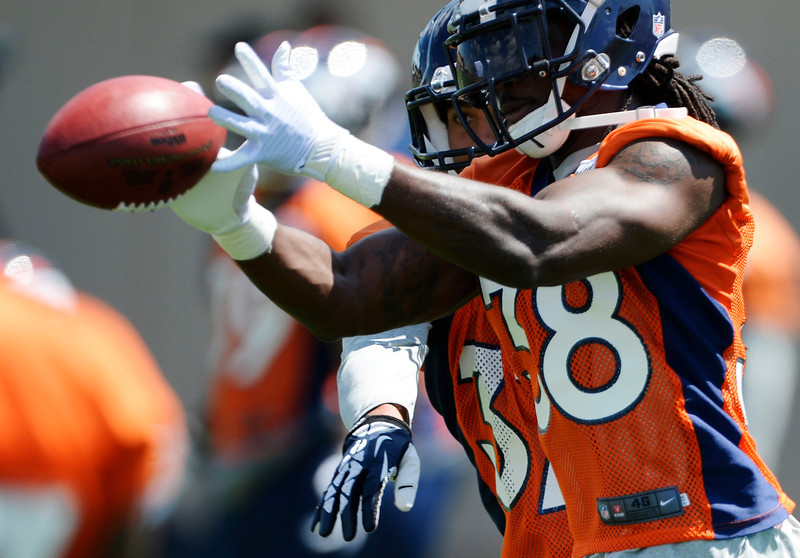 . Denver Broncos Quinton Carter (38) catches a pass as Eric Hagg (37) defends on the play in drills during OTAs June 12, 2014 at Dove Valley. (Photo by John Leyba/The Denver Post)