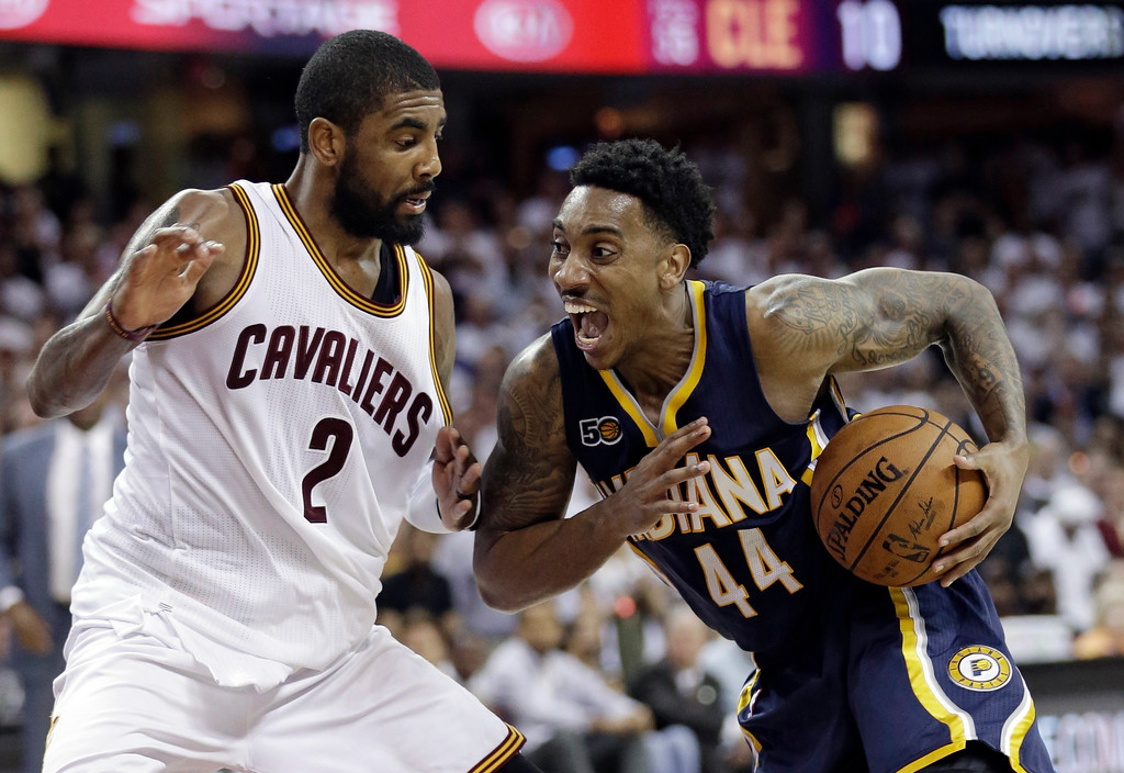. Indiana Pacers\' Jeff Teague (44) drives past Cleveland Cavaliers\' Kyrie Irving (2) in the second half in Game 1 of a first-round NBA basketball playoff series, Saturday, April 15, 2017, in Cleveland. The Cavaliers won 109-108. (AP Photo/Tony Dejak)