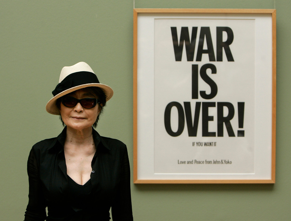 . Artist Yoko Ono poses next to one of her works \'War is over! If you want it - Love and Peace from John an Yoko\' in the museum of arts (Kunsthalle) in Bremen, northern Germany, on Tuesday, June 12, 2007. The widow of John Lennon shows her \'Instructions for Paintings\' works at the museum until Aug. 5, 2007.(AP Photo/Joerg Sarbach)