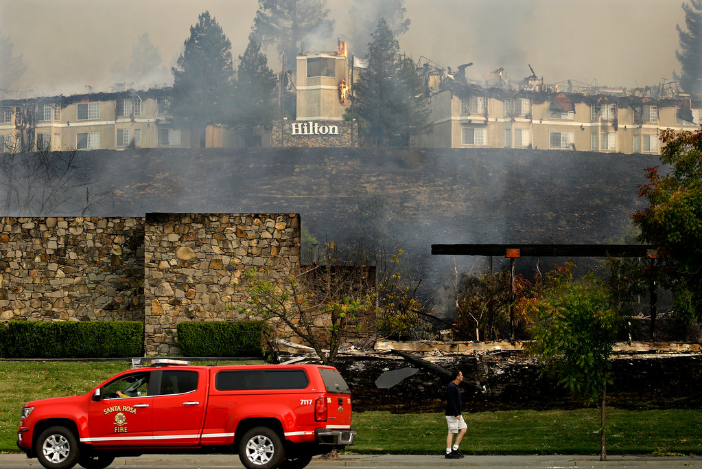 . A fire burns at a Hilton hotel on Monday, Oct. 9, 2017, in Santa Rosa, Calif. Wildfires whipped by powerful winds swept through Northern California sending residents on a headlong flight to safety through smoke and flames as homes burned. (AP Photo/Ben Margot)