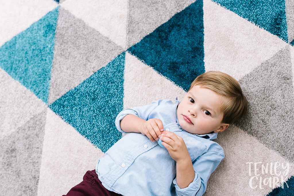 Little boy on triangle blue rug. Lifestyle in-home family photoshoot in Marin, CA by Tenley Clark Photography.