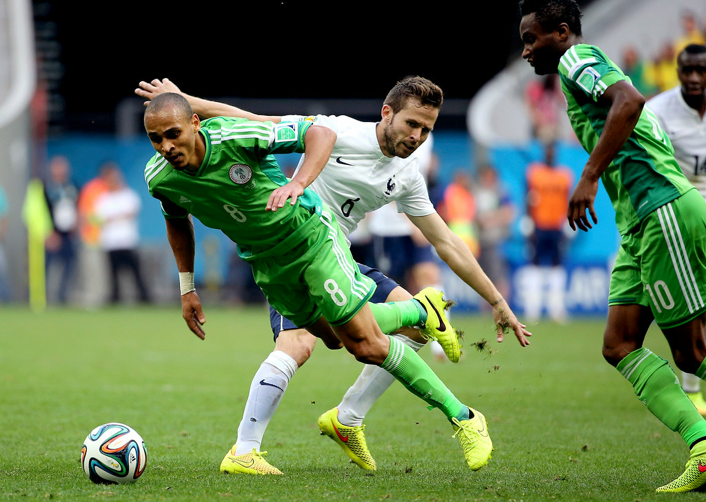 . Nigeria\'s Peter Odemwingie (8)  is challenged by France\'s Yohan Cabaye during the World Cup round of 16 soccer match between France and Nigeria at the Estadio Nacional in Brasilia, Brazil, Monday, June 30, 2014. (AP Photo/David Vincent)