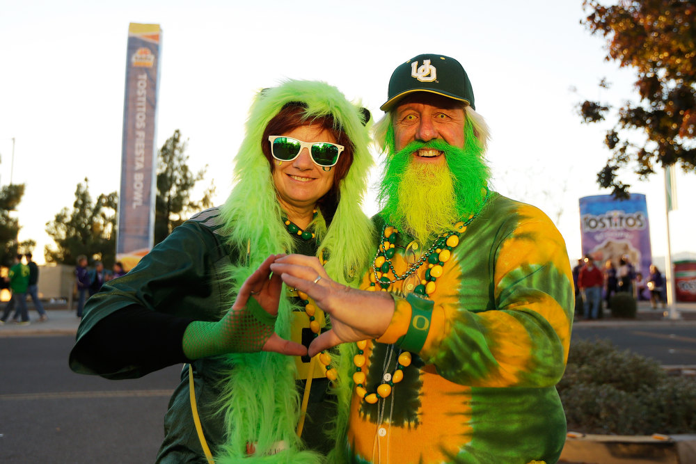 Description of . Oregon Ducks fans Karnajo and John Free of Olympia, Washington pose prior to the Tostitos Fiesta Bowl against the Kansas State Wildcats at University of Phoenix Stadium on January 3, 2013 in Glendale, Arizona.  (Photo by Ezra Shaw/Getty Images)