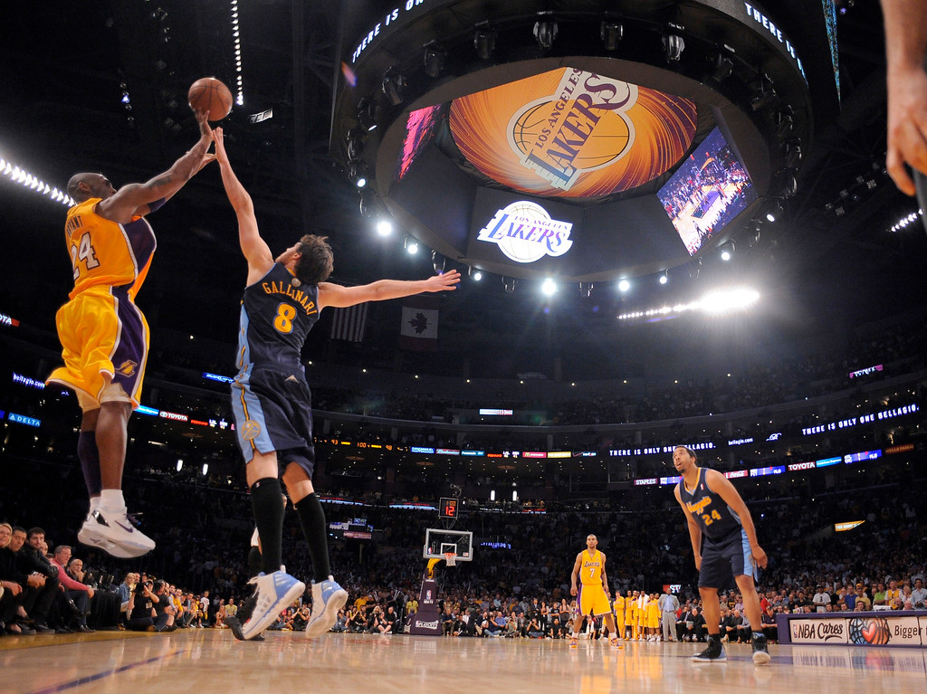 . Los Angeles Lakers shooting guard Kobe Bryant (24) hits a three pointer over Denver Nuggets small forward Danilo Gallinari (8) for a game high 43 points in game 5 of the first round of the NBA playoffs Tuesday, May 8, 2012 at Staples Center. John Leyba, The Denver Post