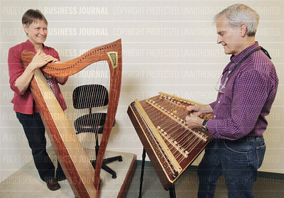 Sue and Ray Mooers of Dusty Strings manufacture artisan-wood harps and hammered dulcimers in Seattle, Washington