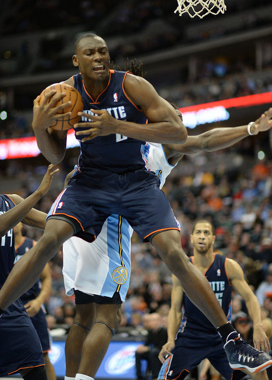 . Bismack Biyombo of the the Charlotte Bobcats controls the rebound during the second half of the game against the Denver Nuggets at Pepsi Center in Denver on Jan. 29, 2014. Charlotte won 101-98. (Photo by Hyoung Chang/The Denver Post)