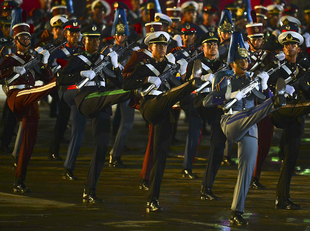 . Troops parade after the installation of Venezuelan President Nicolas Maduro in Caracas on April 19, 2013.  LUIS ACOSTA/AFP/Getty Images
