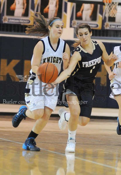 Freeport's Zoe Soilis strips the ball from Knoch's Abbie Thrower at Knoch High School on Thursday, December 12, 2013.  (Tye Cypher for the Butler Eagle)