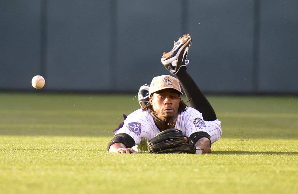 . Denver, CO. - June 08: Eric Young of Colorado Rockies (1) fumbled the ball hit by Carlos Quentin of San Diego Padres (18) in the 7th inning of the game at Coors Field. Denver, Colorado. June 8, 2013. San Diego won 4-2. (Photo By Hyoung Chang/The Denver Post)