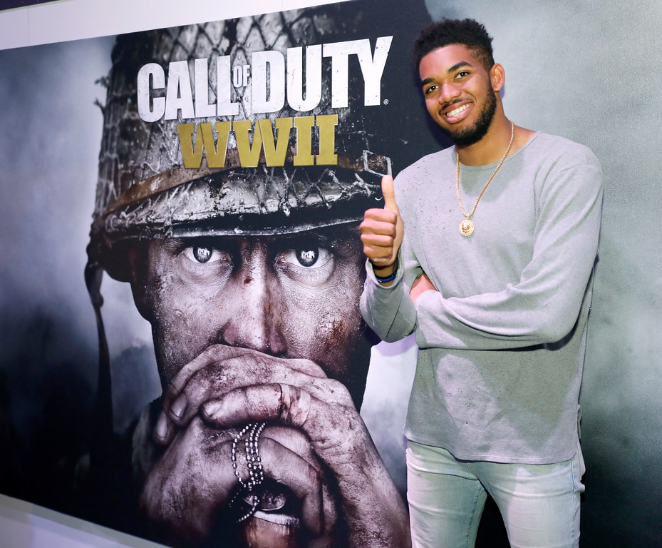 ". IMAGE DISTRIBUTED FOR ACTIVISION - Karl-Anthony Towns, sponsored by Activision, visits the ""Call of Duty: WWII\"" booth during E3 2017 at the Los Angeles Convention Center on Tuesday, June 13, 2017, in Los Angeles, Calif. (Photo by Colin Young-Wolff/Invision for Activision/AP Images)"