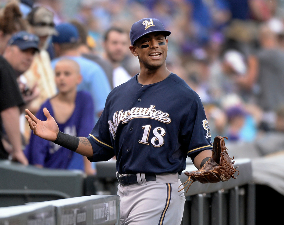 . DENVER, CO - JUNE 20: Milwaukee pitcher Khris Davis gestured as he walked to the dugout before the game. The Colorado Rockies hosted the Milwaukee Brewers at Coors Field Saturday afternoon, June 21, 2014. Photo by Karl Gehring/The Denver Post