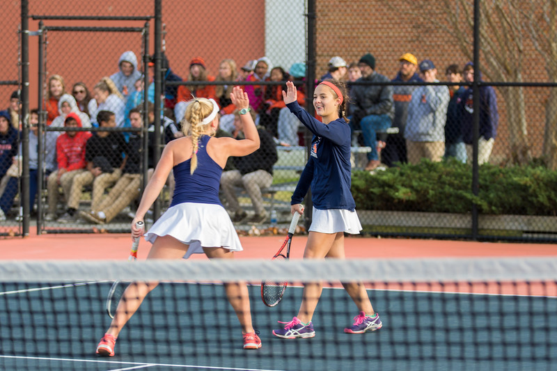 Jane Carter Chandler celebrates a point with Caitie Sullivan at #1 doubles