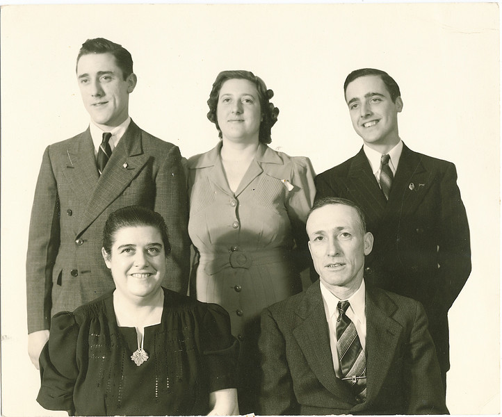 """Front row: Mabelle Elizabeth (Coursey) Dew (1896-1961), Byron Elmer Dew (1893-1986),  Back row:  Robert """" Bob"""" Eugene Dew (1922-1971), Margaret Louise (Dew) Yount (1916-2003), Alvin Glen Dew (1920-2006)  Written on the back of the photograph in Rogers Reunion Photo Album Volume III page 36 """"Elmer Dew and family about 1940  Back row: Bob, Margaret (Yount), Glen  Front row: Mabel (sic), Elmer"""""""