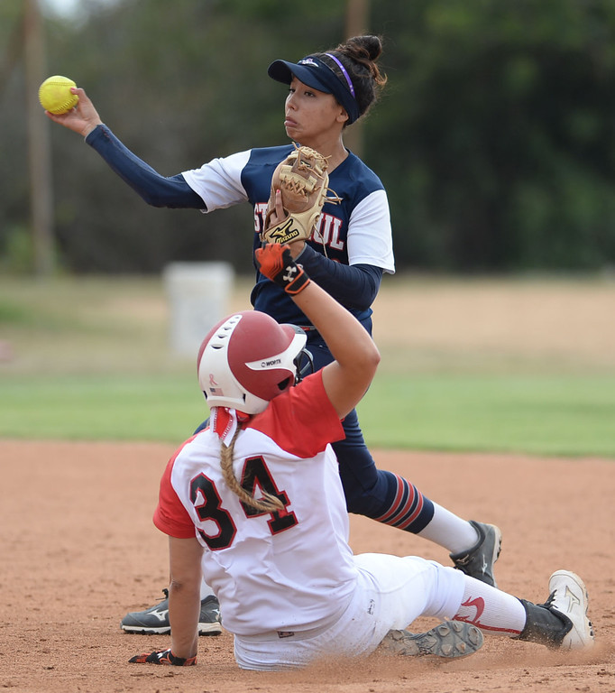 . St. Paul\'s Bryanna Campos (40) turns a double play as Palos Verdes\' Kasey Halleen (34) slides into second in a CIF-SS Division III semifinal softball game Tuesday, May 27, 2014, Palos Verdes Estates, CA.   Palos Verdes lost 10-0. Photo by Steve McCrank/Daily Breeze